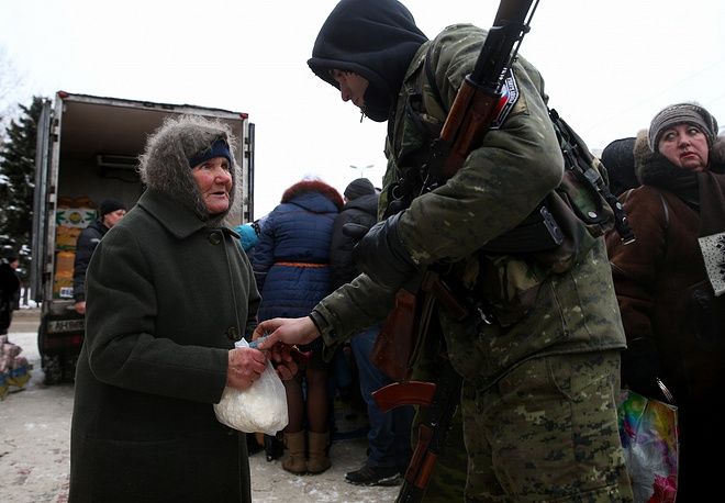 Photo: A member of the Donetsk People's Republic militia seen at a market in the town of Makiivka, Donetsk region