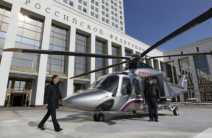 "Chapter 6. The Government of the Russian Federation. ""The decisions and orders of the Government of the Russian Federation shall be obligatory for fulfillment in the Russian Federation"".  Photo: Russian Prime Minister Dmitry Medvedev at a helicopter pad outside the White House, a government building in Moscow"