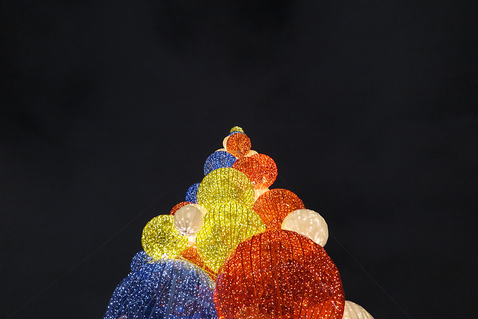 Christmas tree made of colorful illuminated balls in Gorky park in Moscow, Russia