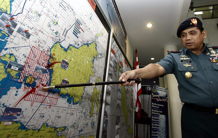 Indonesia took the lead in search operation for the airliner, because the contact was lost with the jet, when it was flying in its responsibility zone. Photo: Commander of the Search and Rescue (SAR) Team of the Indonesian Navy points to a search area on a map at the Navy Port, in Batam, Riau, Indonesia