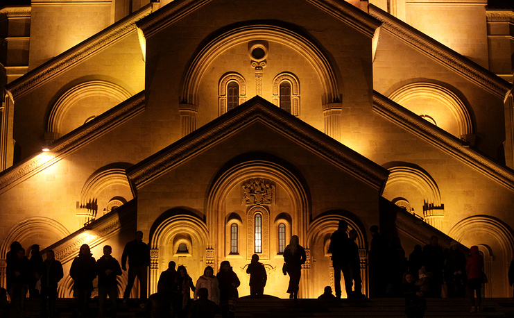 Georgian Orthodox believers gather at the Trinity Cathedral during a Christmas Mass in Tbilisi, Georgia