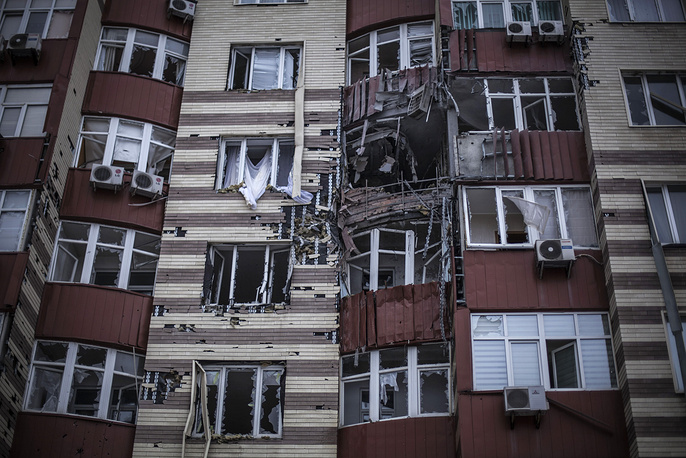 Photo: A building hit by the Ukrainian Army artillery in Donetsk