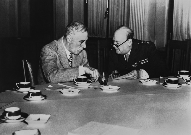 US President Franklin D. Roosevelt confers at the luncheon table with Prime Minister Winston Churchill of Great Britain at the Palace in Yalta, Crimea, February 12, 1945