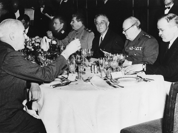 Soviet Marshal Joseph Stalin, US President Franklin D. Roosevelt and British Prime Minister Winston Churchill (left to right, center of table) sit together at the final dinner held in connection with the conference at Yalta, Crimea, Russia, February 11, 1945. Others are US Secretary of State Edward R. Stettinius, Jr., British Foreign Minister Anthony Eden and Russian foreign commissioner Vyacheslav Molotov
