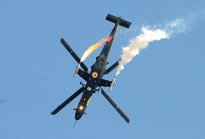 An Indian Air Forces' Hindustan Aeronautics Limited (HAL) Light Combat Helicopter (LCH) performing aerobatics
