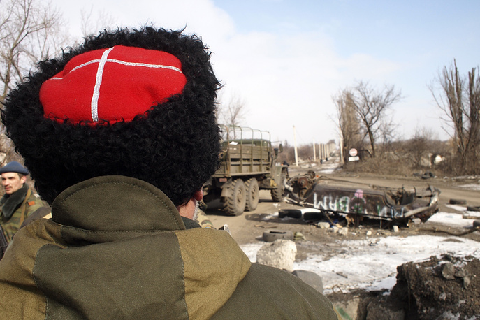 "Donetsk region' self-defense militia command previously reported that a Ukrainian force grouping numbering 8,000 men opposed them in the Debaltsevo area when the encirclement manoeuvre was launched. Photo: Cossack commander Nikolai Kozitsyn, known to his fellow militia fighters by the nom de guerre ""Daddy"""