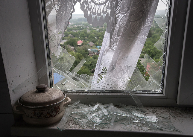 A damaged apartment in a residential neighbourhood of Luhansk in the aftermath of a shell attack by mobile units of the Ukrainian armed forces, July 2014