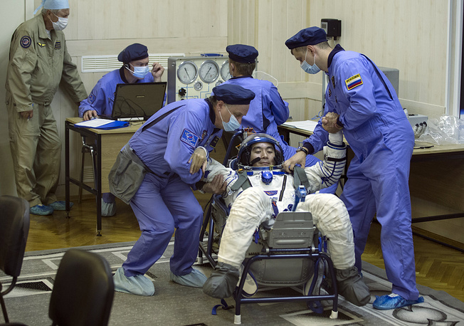 Russian Space Agency experts testing a space suit of Japan astronaut Kimiya Yui