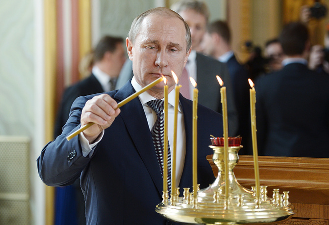 Russia's President Vladimir Putin in the renovated Church of St. Vladimir in the Old Gardens