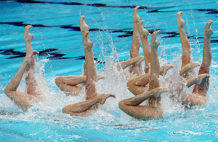 Members of the Russian team performing their technical routine during the Women's Synchronized Swimming Team event, July 27