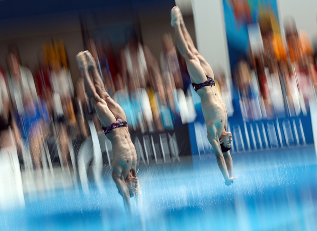 Tze Liang Ooi and Ahmad Azman of Malaysia competing in the men's synchronised 3m springboard final, July 28