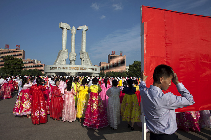 According to the World Bank, the population of Pyongyang is 2.5 million people. Photo: Folk dancing held in front of the Monument to Party Founding in Pyongyang