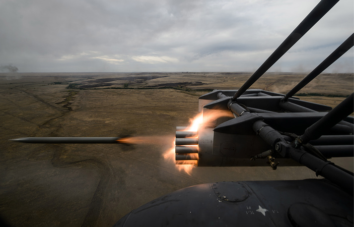 A Mi-8 helicopter firing free flight rockets during the Center-2015 military drills