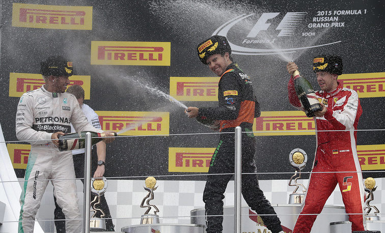 Lewis Hamilton, Sergio Perez and Sebastian Vettel spraying champagne after the Formula 1 Russian Grand Prix in Sochi