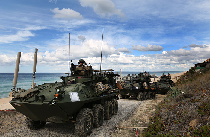 US marine armoured vehicles leaving the beach after getting off from US Navy hovercrafts at Raposa Media beach in Pinheiro da Cruz, south of Lisbon