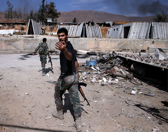 A soldier of the Syrian government's troops during a military operation in Harasta, Damascus
