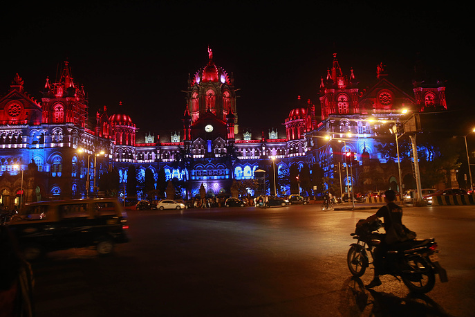 Chhatrapati Shivaji train station building illuminated by the colors of the French national flag, Mumbai, India
