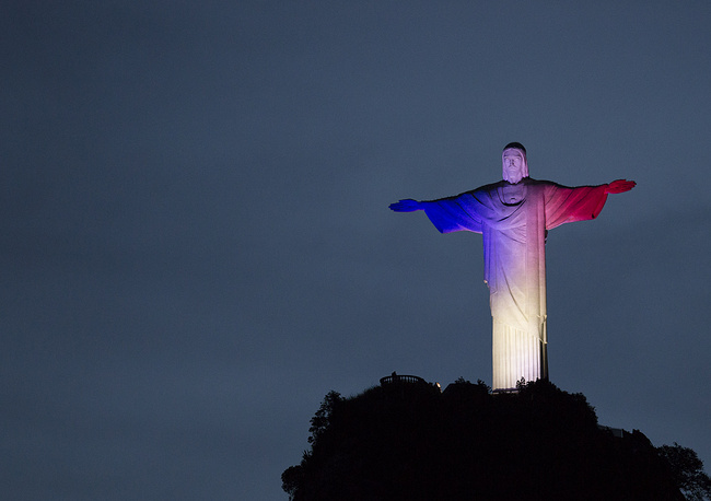 Christ the Redeemer statue lit with the colors of France's flag, Rio de Janeiro, Brazil