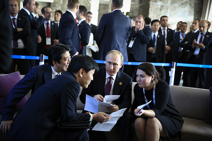 Russian President Vladimir Putin meeting with Japan's Prime Minister Shinzo Abe