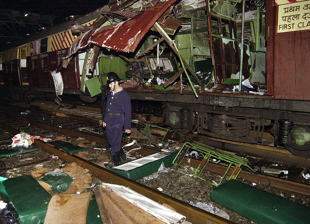 2006 Mumbai train bombings. Series of seven bomb blasts took place on the Suburban Railway in Mumbai on 11 July 2006 killing 209 people. Photo: A fire officer near a train coach destroyed in a bomb blast in Bombay, India, 2006