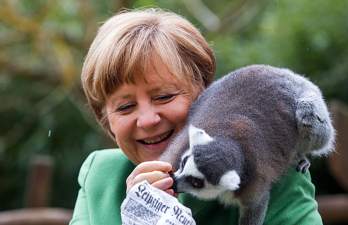 Angela Merkel feeding a lemur during her visit at the bird park in Marlow, Germany, April 30, 2015
