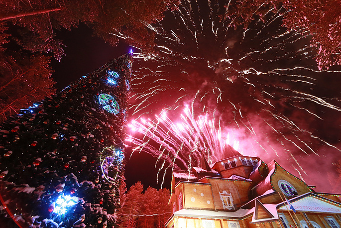 Fireworks go off over a Christmas tree during a celebration marking Father Frost's birthday at his residence in the town of Veliky Ustyug, November 18, 2015