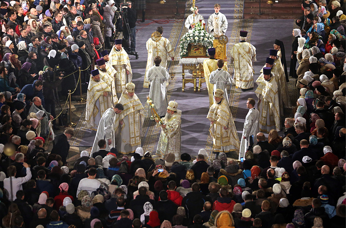 Orthodox believers at Christmas service in the Kazan Cathedral in Saint Petersburg, Russia
