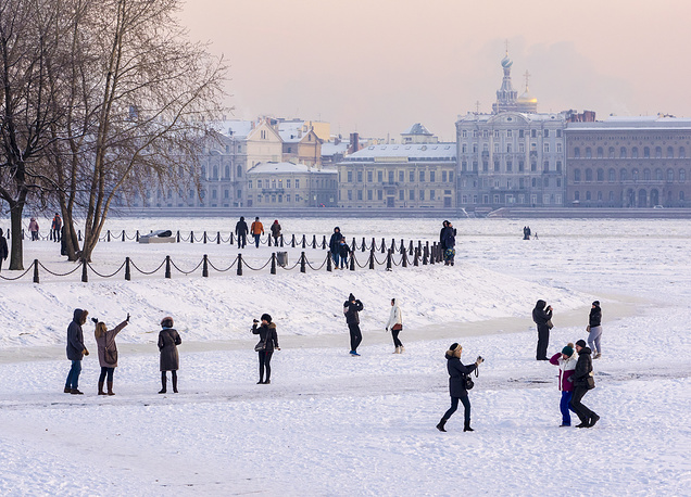 Citizens walking on the ice of the Neva River near the Peter and Paul Fortress in Saint Petersburg