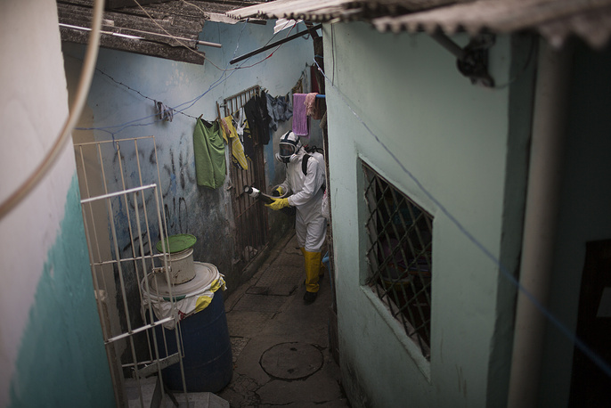 A municipal worker spraying insecticide to combat the Aedes aegypti mosquitoes at the Imbiribeira neighborhood in Recife, Brazil