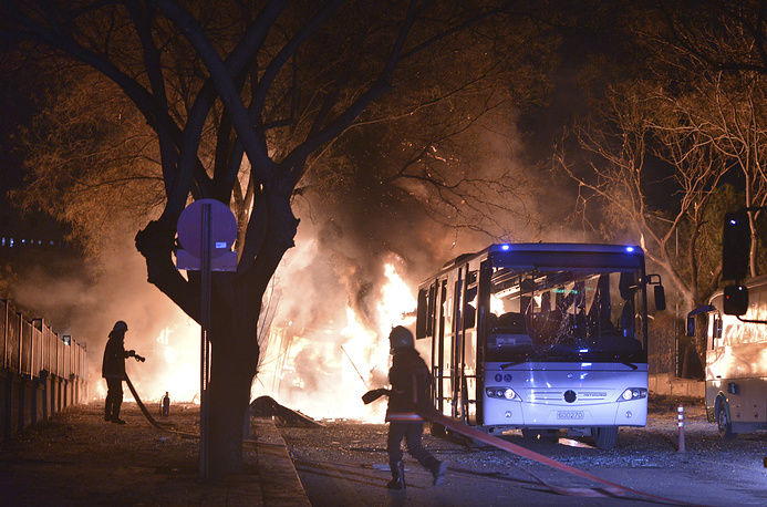 Firefighters work at a scene of fire from an explosion in Ankara