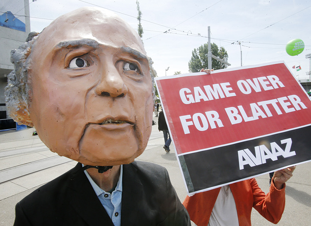 Protester wearing a mask depicting FIFA President Sepp Blatter in front of the building where the 65th FIFA congress took place in Zurich, Switzerland