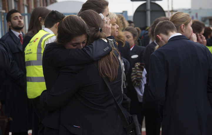 Passengers and airport staff are evacuated from the terminal building after explosions at Brussels Airport in Zaventem