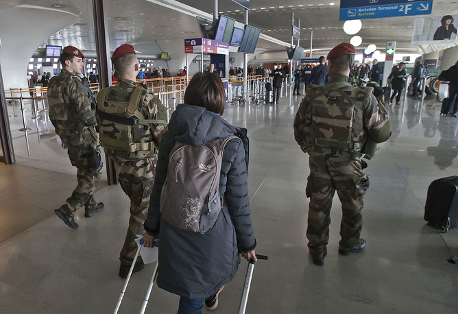 French soldiers patrol at Charles de Gaulle airport, north of Paris, following terror attacks in Brussels