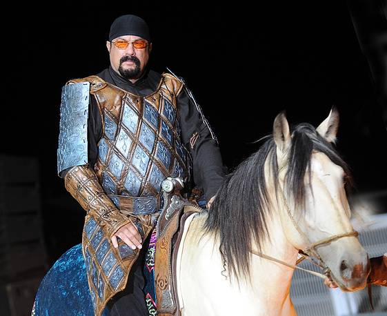 Hollywood actor Steven Seagal riding a horse at the opening ceremony