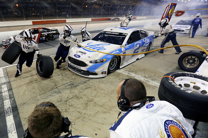 Brad Keselowski, driver of the #2 Miller Lite Ford, pits during the NASCAR Sprint Cup Series Bojangles' Southern 500 at Darlington Raceway, USA, September 4