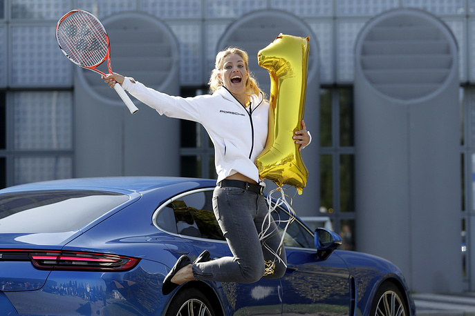 Germany's Angelique Kerber, WTA No. 1, who won the US Open tennis final, jumping after her arrival in Munich, Germany, September 13