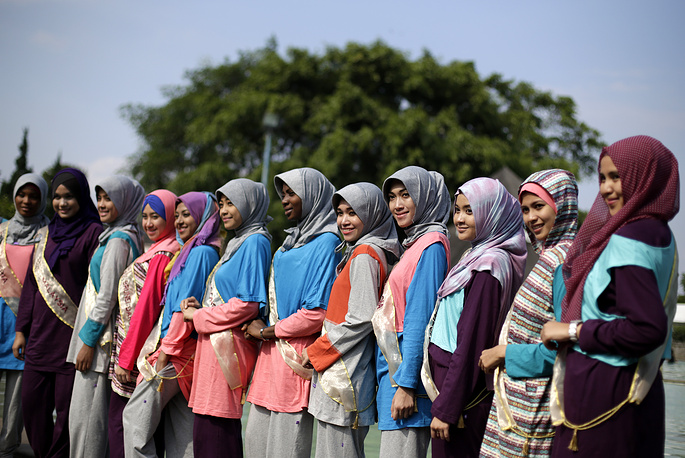 The World Muslimah is an annual international beauty pageant for young Muslim women who are judged to have shown dedication, reputation and concern for Islamic values. Photo: Participants of the World Muslimah 2013 in Subang, Indonesia
