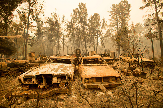Vintage cars line a property after the Loma fire burned through Loma Chiquita Road near Morgan Hill, California, Sept. 28
