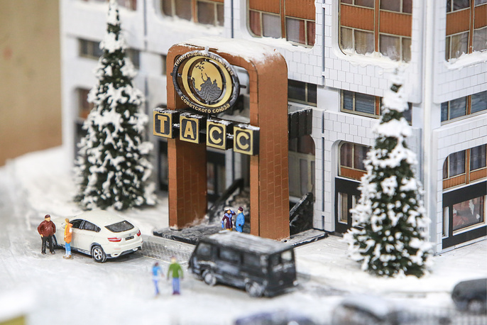 A mockup of the building of TASS News Agency, a part of a miniature version of  Russia displayed at the Grand Maket museum in Saint Petersburg, October 10