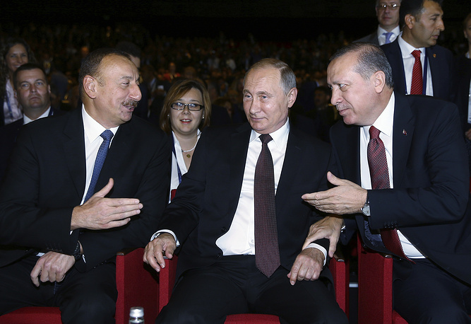 Turkey's President Recep Tayyip Erdogan, Russian President Vladimir Putin, and Azerbaijan's President Ilham Aliyev at a session of the World Energy Congress, in Istanbul, October 10