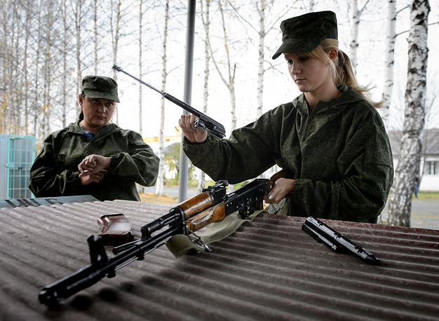 A member of a rapid action team takes a rifle strip and assembly exam