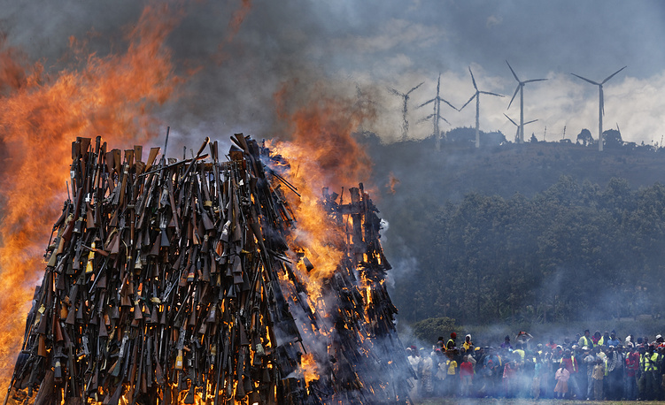 A pile of 5,250 illegal weapons burned by Kenyan police in Ngong, near Nairobi, in Kenya, November 15