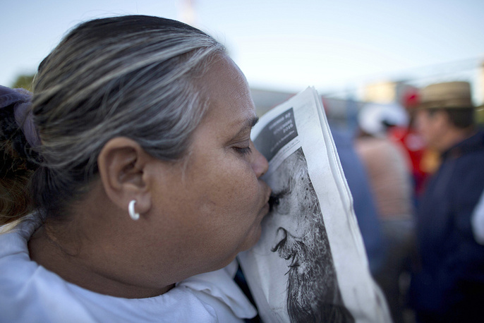 A woman in line waiting to enter Revolution Square for the start of week-long services bidding farewell to Fidel Castro in Havana