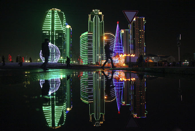 A Christmas tree and skyscrapers illuminated for New Year celebration in downtown Grozny, the capital of Chechnya, Russia, December 28