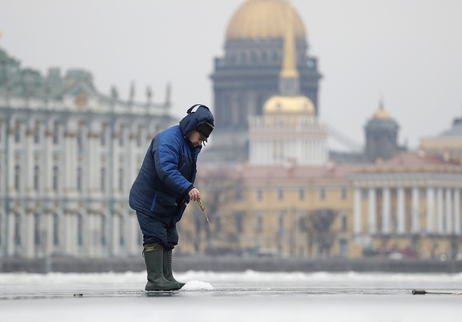 According to the St. Isaac's Cathedral museum's director, Nikolay Burov, the museum at the cathedral is one of Russia's most popular and visited by some 3.5 mln tourists annually. Photo: A man fishes through an ice hole on the Neva River in St.Petersburg, with the St. Isaac's Cathedral in the background