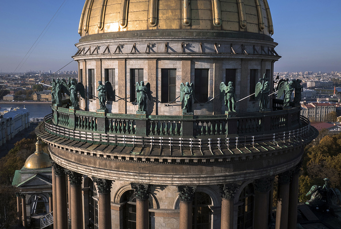 Sculptures of 24 angels were installed on their plinths 63 meters above the ground after five years restoration. Photo: 'Angel balustrade' at the St. Isaac's Cathedral