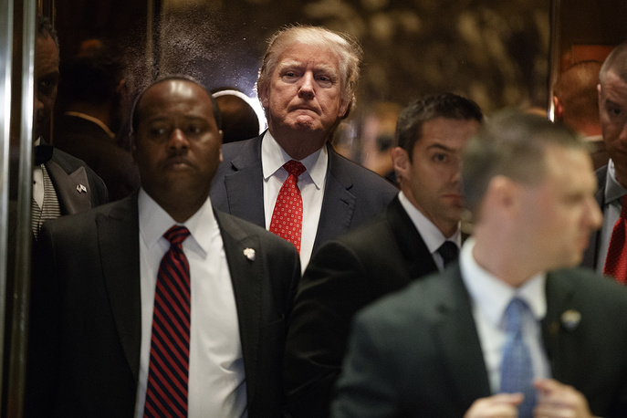 President-elect Donald Trump gets on an elevator after speaking with reporters at Trump Tower in New York, USA, January 9