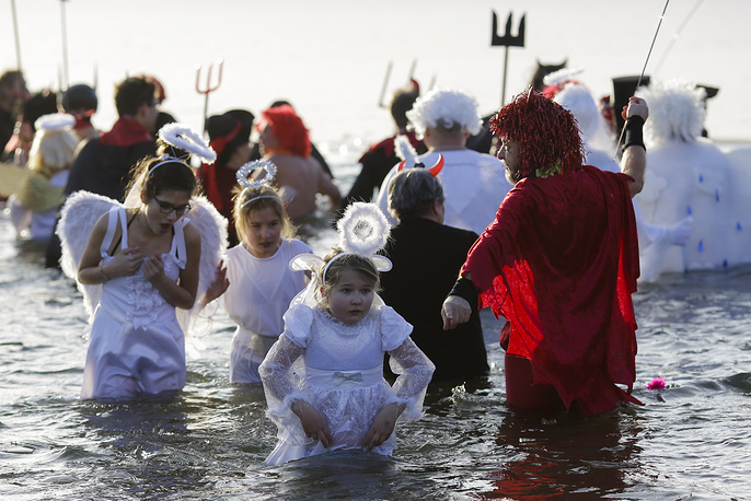 People in costumes celebrate in the frozen lake Orankesee during a so called 'Ice Carnival' event in Berlin, Germany, January 14