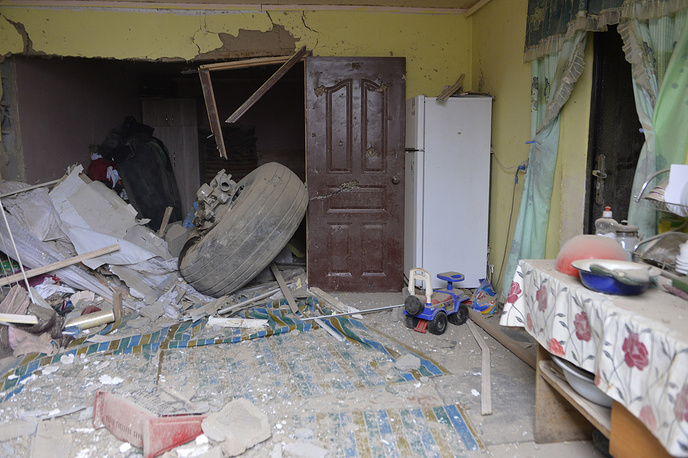 A plane wheel inside a damaged house at a crash site of the Turkish Boeing 747 cargo plane at a residential area outside Bishkek, Kyrgyzstan, January 17