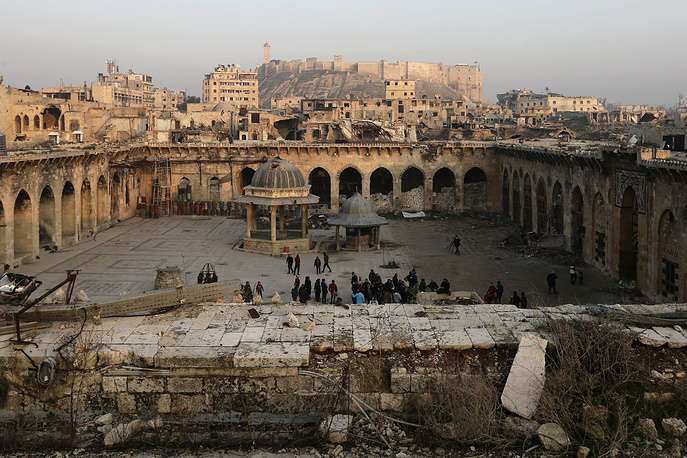 A view of the Aleppo citadel and heavily damaged Grand Umayyad mosque in the old city of Aleppo